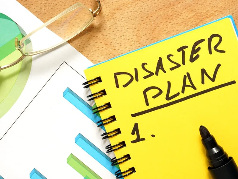 Affiliated Blog Disaster Recovery Notepad with disaster plan on a wooden table