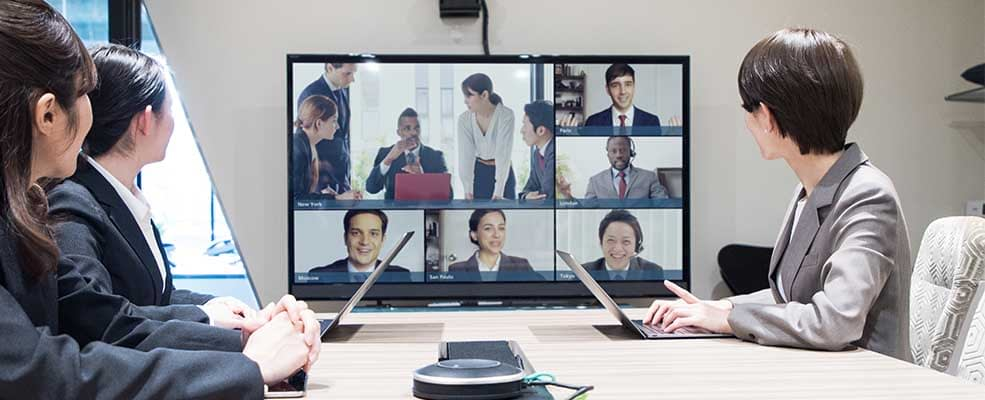 Office meeting with video call with multiple people
