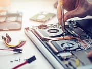 Affiliated Blog maintenance services technician repairing laptop computer closeup